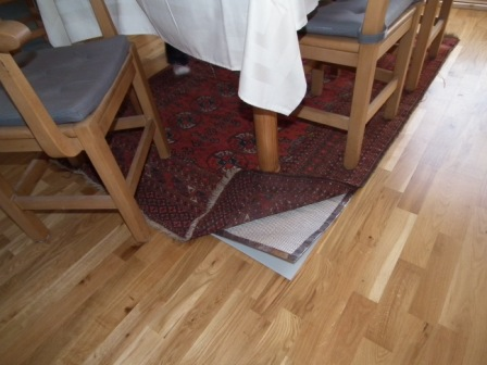 RugBuddy Under Rug Heater revealed in Dining Room