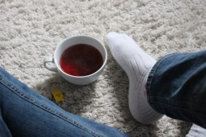 Jeans, socks, tea on a warmed rug (to beat a cold floor)