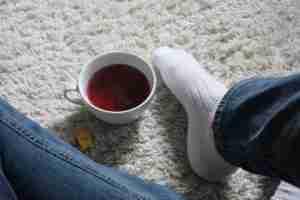 Jeans, socks, tea on a warm rug